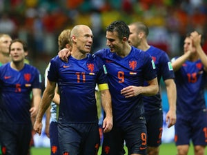 Arjen Robben (L) and Robin van Persie of the Netherlands walk off the field after scoring two goals each and defeating Spain 5-1 during the 2014 FIFA World Cup on June 13, 2014