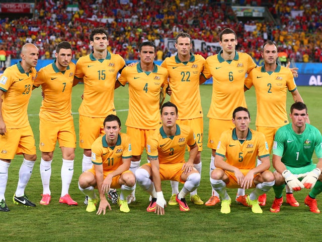 Australia line up for a team photo before the 2014 FIFA World Cup Brazil Group B match between Chile and Australia at Arena Pantanal on June 13, 2014