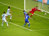 Sead Kolasinac of Bosnia and Herzegovina scores an own goal past goalkeeper Asmir Begovic as Ezequiel Garay and Federico Fernandez of Argentina look on during the 2014 FIFA World Cup Brazil Group F match between Argentina and Bosnia-Herzegovina at Maracan