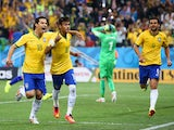 Neymar of Brazil celebrates his second goal with Hernanes in the second half during the 2014 FIFA World Cup Brazil Group A match between Brazil and Croatia at Arena de Sao Paulo on June 12, 2014