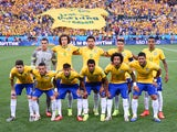 The Brazil team pose prior to the 2014 FIFA World Cup Brazil Group A match between Brazil and Croatia at Arena de Sao Paulo on June 12, 2014