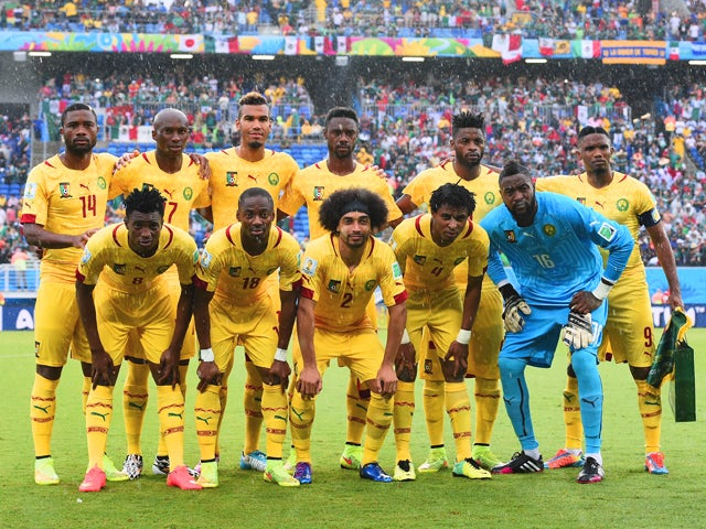 Cameroon players pose for a team photo before the 2014 FIFA World Cup Brazil Group A match between Mexico and Cameroon at Estadio das Dunas on June 13, 2014