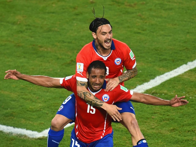 Jean Beausejour of Chile celebrates scoring his teams third goal with Mauricio Pinilla during the 2014 FIFA World Cup Brazil Group B match between Chile and Australia at Arena Pantanal on June 13, 2014