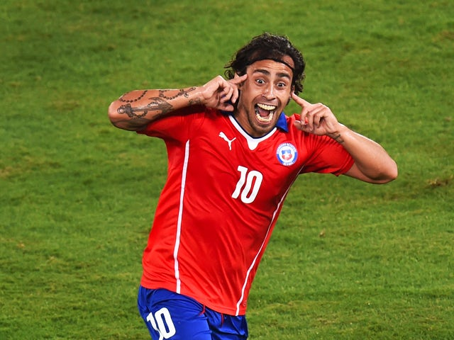Jorge Valdivia of Chile celebrates after scoring the teams second goal during the 2014 FIFA World Cup Brazil Group B match between Chile and Australia at Arena Pantanal on June 13, 2014