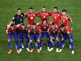 Chile national team pose prior to a Group B football match between Chile and Australia at the Pantanal Arena in Cuiaba during the 2014 FIFA World Cup on June 13, 2014