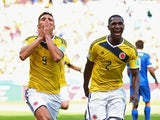 Teofilo Gutierrez of Colombia and Cristian Zapata celebrate after the second goal during the 2014 FIFA World Cup Brazil Group C match between Colombia and Greece at Estadio Mineirao on June 14, 2014