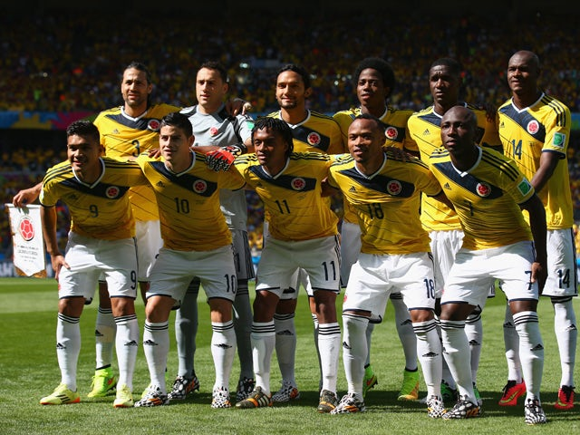 Colombia players pose for a team photo before the 2014 FIFA World Cup Brazil Group C match between Colombia and Greece at Estadio Mineirao on June 14, 2014