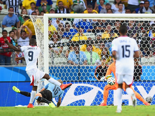 Joel Campbell of Costa Rica shoots and scores his team's first goal during the 2014 FIFA World Cup Brazil Group D match between Uruguay and Costa Rica at Castelao on June 14, 2014
