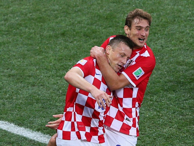 Ivica Olic and Nikica Jelavic of Croatia celebrate after a first half goal during the 2014 FIFA World Cup Brazil Group A match between Brazil and Croatia at Arena de Sao Paulo on June 12, 2014