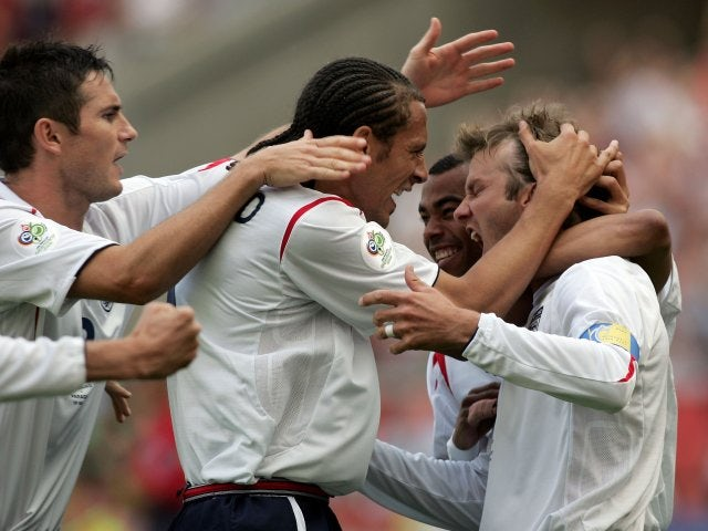 David Beckham celebrates with his England teammates after scoring against Paraguay on June 10, 2006.