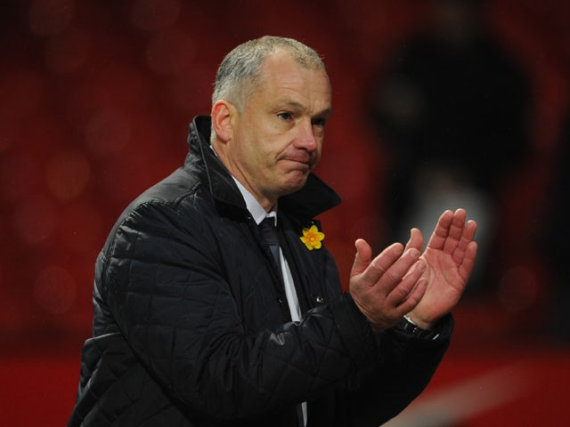 Reading Caretaker Manager Eamonn Dolan applauds the fans at the end of the Barclays Premier League match between Manchester United and Reading at Old Trafford on March 16, 2013