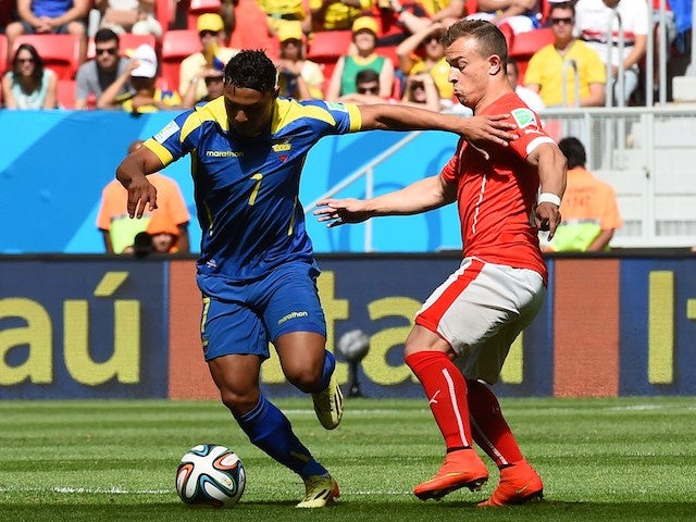 Ecuador's forward Jefferson Montero (L) vies with Switzerland's midfielder Xherdan Shaqiri during their Group E World Cup football match in Brasilia on June 15, 2014