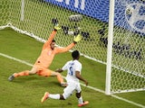 England's forward Daniel Sturridge scores during a Group D football match between England and Italy at the Amazonia Arena in Manaus during the 2014 FIFA World Cup on June 14, 2014