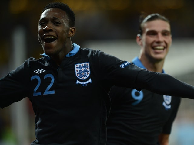 English forward Dany Welbeck celebrates with Andy Carroll after scoring a goal during the Euro 2012 championships football match Sweden vs England on June 15, 2012