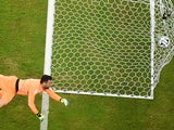 Italy's goalkeeper Salvatore Sirigu jumps to save a goal during a Group D football match between England and Italy at the Amazonia Arena in Manaus during the 2014 FIFA World Cup on June 14, 2014