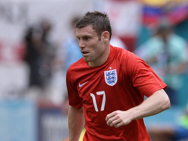 England midfielder James Milner dribbles during the friendly match between England and Ecuador at Miami Sun Life Stadium in Miami Gardens, Florida on June 4, 2014