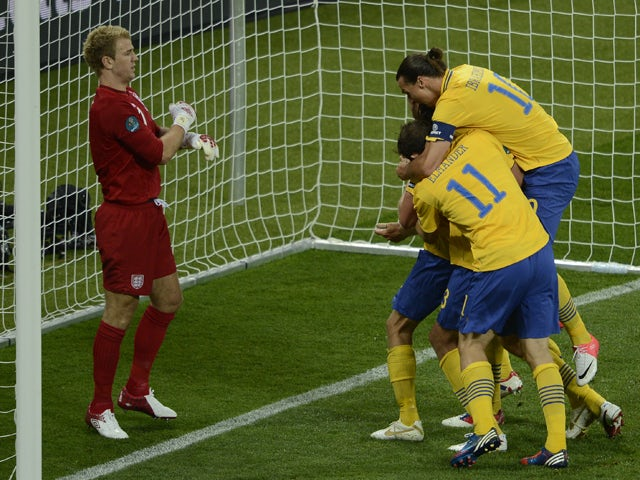 Swedish players celebrate after scoring during the Euro 2012 championships football match Sweden vs England on June 15, 2012