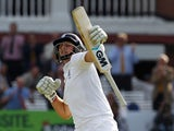 Englands Joe Root celebrates reaching a century not out during play on the first day of the first cricket Test match between England and Sri Lanka at Lord's cricket ground in London on June 12, 2014