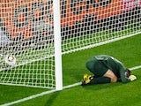England's goalkeeper Robert Green reacts after missing a goal during their Group C first round 2010 World Cup football match on June 12, 2010