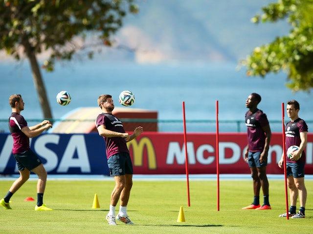 England players Jordan Henderson, Steven Gerrard, Danny Welbeck and Leighton Baines train for the World Cup in Rio de Janeiro on June 10, 2014