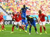 Ecuador's Enner Valencia heads home the opening goal in their World Cup Group E match against Switzerland in Brasilia on June 15, 2014