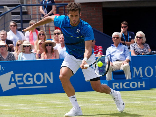 Spain's Feliciano Lopez returns against Australia's Lleyton Hewitt during their second round match on the third day of the ATP Aegon Championships tennis tournament at The Queen's Club in west London, on June 11, 2014