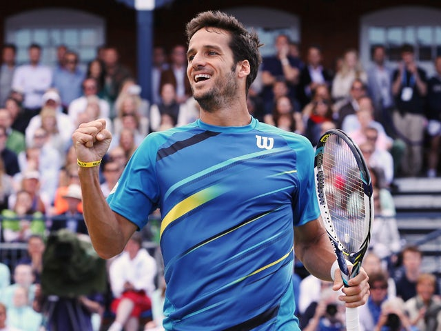 Feliciano Lopez of Spain celebrates victory over Radek Stepanek of the Czech Republic during their Men's Singles semi-final match on day six of the Aegon Championships at Queens Club on June 14, 2014