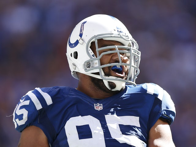 Fili Moala #95 of the Indianapolis Colts celebrates after a defensive stop against the Minnesota Vikings during the game at Lucas Oil Stadium on September 16, 2012