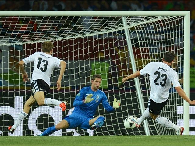 German forward Mario Gomez scores past Dutch goalkeeper Maarten Stekelenburg during the Euro 2012 championships football match the Netherlands vs Germany on June 12, 2012