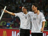 Mario Gomez of Germany celebrates scoring their second goal with Mesut Ozil of Germany during the UEFA EURO 2012 group B match between Netherlands and Germany at Metalist Stadium on June 13, 2012