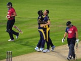 Michael Hogan of Glamorgan celebrates with Darren Sammy of Glamorgan after taking the wicket of Adam Ball of Kent during the NatWest t20 Blast match between Glamorgan and Kent Spitfires at The Swalec Stadium on June 13, 2014