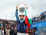 Bulgaria's Grigor Dimitrov celebrates with the winners trophy after clinching victory in the AEGON Championships at Queen's Club on June 15, 2014