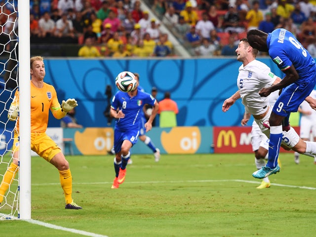 Mario Balotelli of Italy scores his team's second goal on a header past Gary Cahill and goalkeeper Joe Hart of England during the 2014 FIFA World Cup Brazil Group D match between England and Italy at Arena Amazonia on June 14, 2014