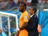 Didier Drogba of the Ivory Coast stands on the sidelines with head coach Sabri Lamouchi during the 2014 FIFA World Cup Brazil Group C match between the Ivory Coast and Japan at Arena Pernambuco on June 14, 2014