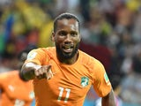 Ivory Coast's forward and captain Didier Drogba celebrates after Ivory Coast's forward Gervinho scored during a Group C football match between Ivory Coast and Japan at the Pernambuco Arena in Recife during the 2014 FIFA World Cup on June 14, 2014