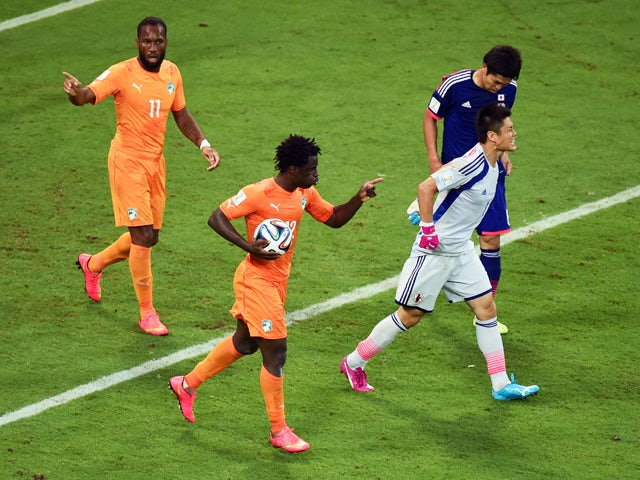 Wilfried Bony of the Ivory Coast celebrates scoring his team's first goal with Didier Drogba as goalkeeper Eiji Kawashima of Japan reacts during the 2014 FIFA World Cup Brazil Group C match between the Ivory Coast and Japan at Arena Pernambuco on June