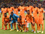 Ivory Coast national team pose prior to the start of a Group C football match between Ivory Coast and Japan at the Pernambuco Arena in Recife during the 2014 FIFA World Cup on June 14, 2014