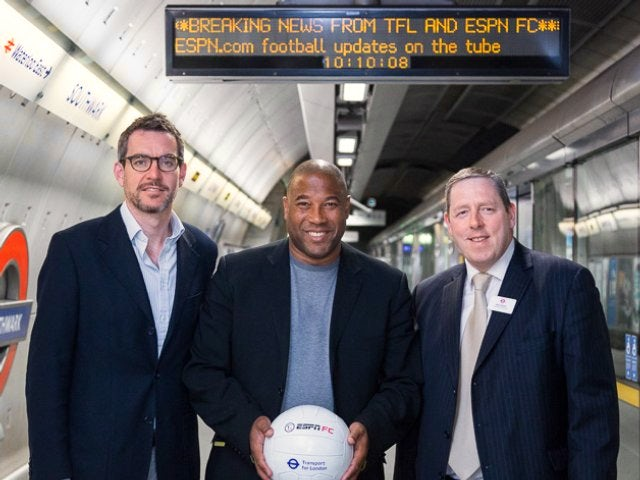 John Barnes poses on the on the London Underground with tube officials on June 10, 2014.