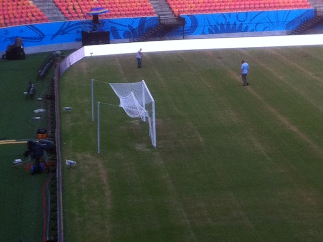 Picture taken from a smartphone from the Press tribune of Manaus stadium showing the pitch of the Amazonia Arena on June 10 2014