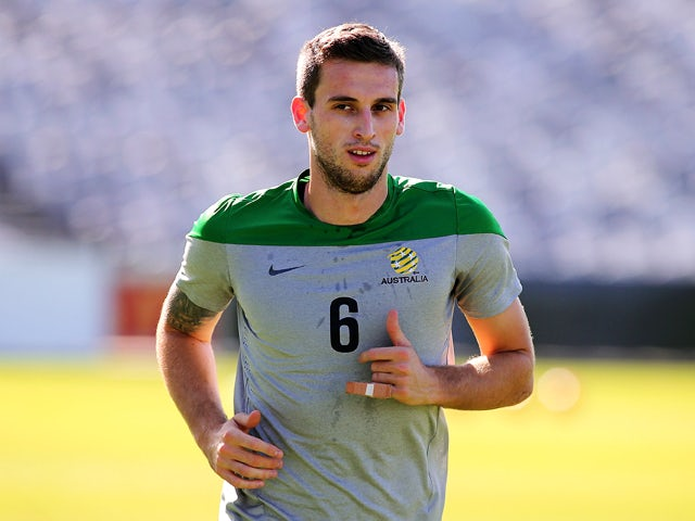 Matthew Spiranovic runs during an Australian Socceroos training session at Central Coast Stadium on May 21, 2014
