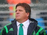 Head coach Miguel Herrera of Mexico looks on from the sideline in the first half during the 2014 FIFA World Cup Brazil Group A match between Mexico and Cameroon at Estadio das Dunas on June 13, 2014