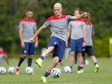 Michael Bradley of the United States runs drills during their training session at Sao Paulo FC on June 11, 2014