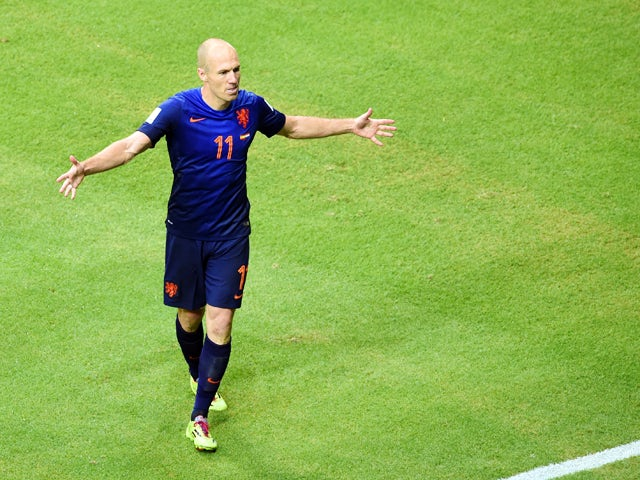 Netherlands' forward Arjen Robben celebrates after scoring during a Group B football match between Spain and the Netherlands at the Fonte Nova Arena in Salvador during the 2014 FIFA World Cup on June 13, 2014