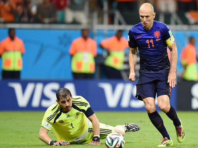 Netherlands' forward Arjen Robben beats Spain's goalkeeper Iker Casillas to score his team's fifth goal during a Group B football match between Spain and the Netherlands at the Fonte Nova Arena in Salvador during the 2014 FIFA World Cup on June 13, 2014