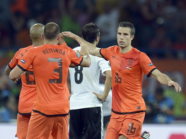 Dutch forward Robin van Persie celebrates after scoring a goal during the Euro 2012 championships football match the Netherlands vs Germany on June 13, 2012