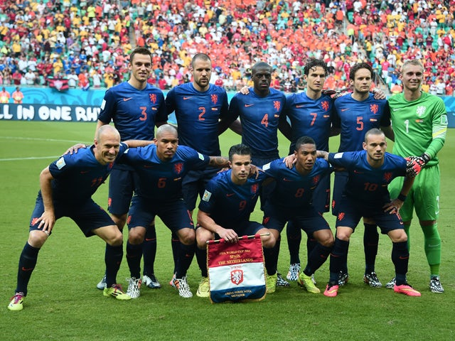 Netherlands players  line up for a photo before a Group B football match between Spain and the Netherlands at the Fonte Nova Arena in Salvador during the 2014 FIFA World Cup on June 13, 2014
