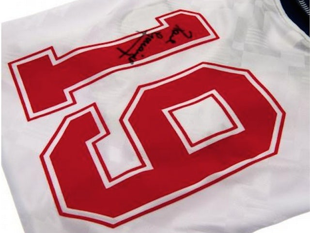 An England 1990 shirt signed by Paul Gascoigne