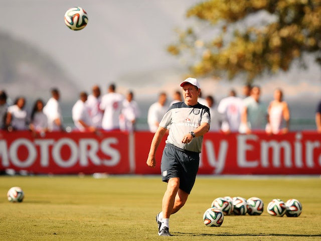 England manager Roy Hodgson kicks a football during a training session in Rio de Janeiro on June 9, 2014