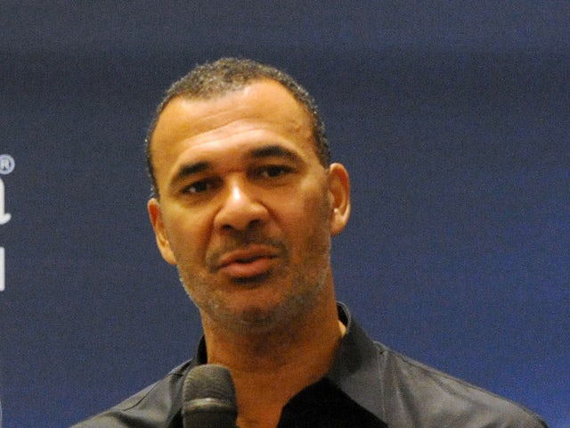 UEFA Trophy Tour Ambassador Ruud Gullit speaks during a press conference in Lagos on March 13, 2014
