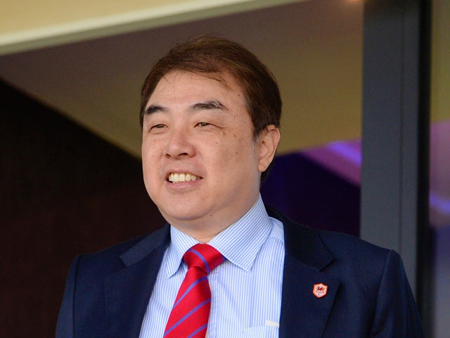 Cardiff City Football Club's Chief Executive Simon Lim looks on during the Barclays Premier League match between West Bromwich Albion and Cardiff City at The Hawthorns on March 29, 2014